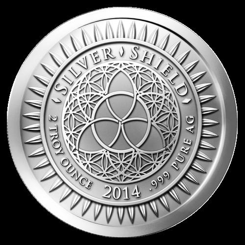 """Das revidierte Silver Shield Logo, mit dem Trivium in der Mitte, eingekreist von den Worten """"Silver Shield 2 Troy ounce 2014 .999 Pure AG"""" (Silver Shield 2 Troy-oz 2014 .999 Reines SILBER), umgeben von 47 Kugeln."""