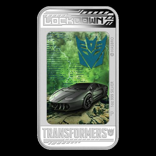 """Ein farbiges Porträt das Lockdown Morphing von """"Lockdown Supercars to a Descepticon"""" zeigt und die Worte """"Lockdown Transformers 1 oz 999 Silver"""" (Lockdown Transformers 1 oz 999 Silber) und das """"P"""" Prägezeichen, sowie Copyright Informationen."""
