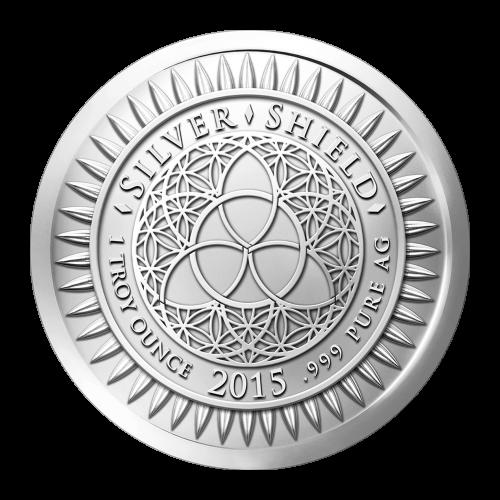 """Das revidierte Silver Shield Logo, mit dem Trivium in der Mitte, eingekreist von den Worten """"Silver Shield 1 ounce 2015 .999 Pure AG"""" (Silver Shield 1 Troy-oz 2015 .999 Reines SILBER), umgeben von 47 Kugeln."""