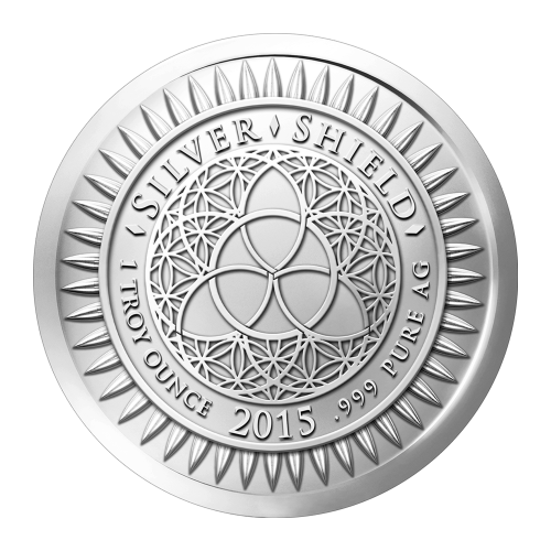 """Das revidierte Silver Shield Logo, mit dem Trivium in der Mitte, eingekreist von den Worten """"Silver Shield 1 Troy ounce 2015 .999 Pure AG"""" (Silver Shield 1 Troy-oz 2015 .999 Reines SILBER), umgeben von 47 Kugeln."""