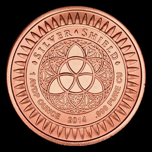 """Das revidierte Silver Shield Logo mit dem Trivium in der Mitte, eingekreist von den Worten """"Silver Shield 1 AVDP ounce 2014 .999 Pure Cu"""" (Silver Shield 1 AVDP oz 2014 .999 reines Kupfer), umgeben von 47 Kugeln."""