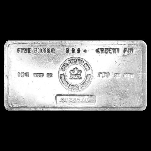 """Das RCM Logo und die Worte """"Fine Silver 999+ Argent Fin 100 Troy oz"""" (Feinsilber 999+ versilbert 100 Troy-Unzen), sowie eine Seriennummer."""
