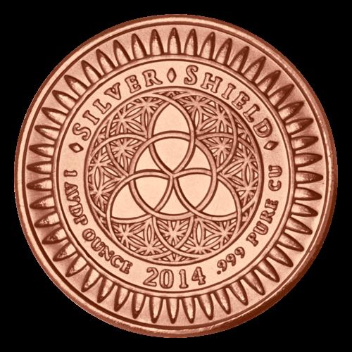 """Das revidierte Silver Shield Logo mit dem Trivium in der Mitte, eingekreist von den Worten """"Silver Shield 1 AVDP ounce 2015 .999 Pure Cu"""" (Silver Shield 1 AVDP oz 2015 .999 reines Kupfer), umgeben von 47 Kugeln."""