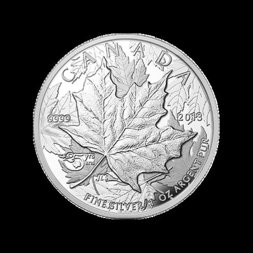 """Überlappende Ahornblätter und die Worte """"Canada 2013 9999 Fine Silver 1 oz Argent Pur 25 yrs ans"""" (Kanada 2013 9999 Feinsilber 1 oz reines Silber 25 Jahre ans)"""