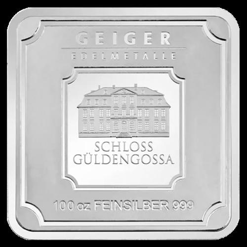 """Das Geiger Edelmetalle Logo, sowie das Bild von deren Hauptbüro und die Worte """"Geiger Edelmetalle Feinsilber 999 100 oz (Unzen)""""."""